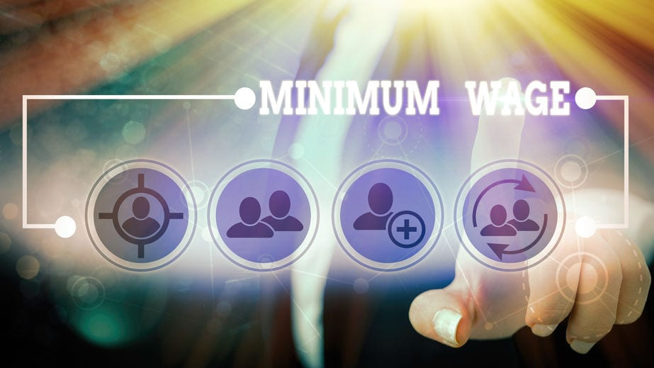 Text sign showing Minimum Wage. Business photo showcasing the lowest wage permitted by law or by a special agreement
