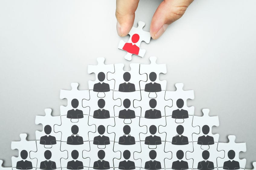 Selecting leader of business organization. Human resource management. Head hunting. Assembling jigsaw puzzle. Organizing business people hierarchy.
