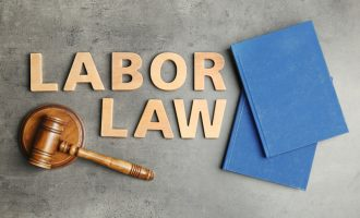 Flat lay composition with words LABOR LAW on grey background