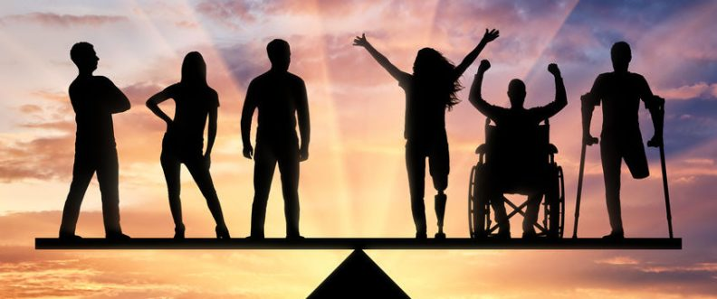 Invalids equal in rights in the balance with healthy people. Concept of social equality of disabled people in society