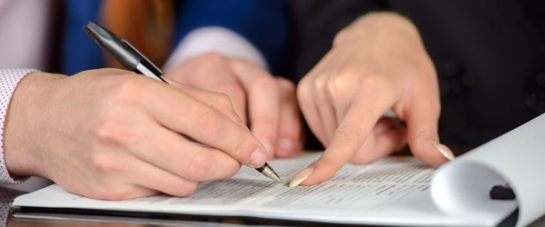Businessman and woman hand signing contract paper